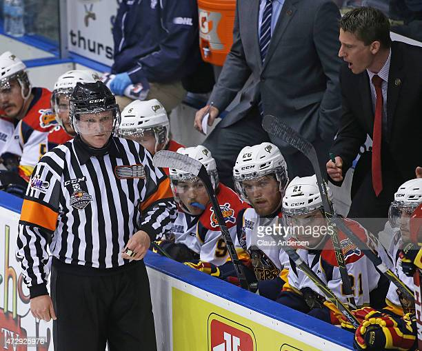 Referee Sean Reade gets an earful from head coach Kris Knoblauch of the Erie Otters during play against the Oshawa Generals in Game Two of the...