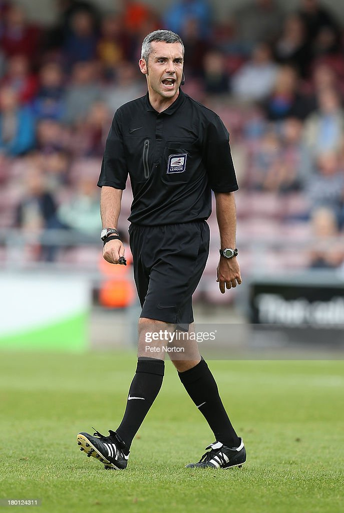 Referee Sebastian Stockbridge in action during the Sky Bet League Two match between Northampton Town and Scunthorpe United at Sixfields Stadium on September 7, 2013 in Northampton, England.
