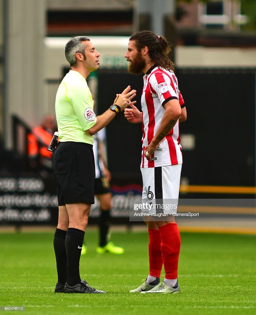 Referee Sebastian Stockbridge speaks to Lincoln City's Michael Bostwick during the Sky Bet League Two match between Notts County and Lincoln City at Meadow Lane on September 23, 2017 in Nottingham, England.