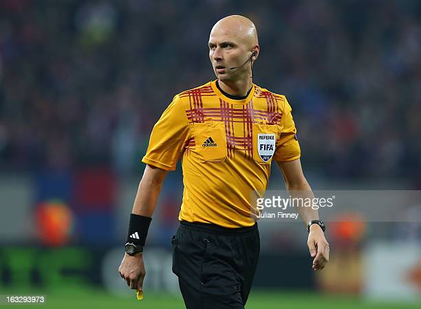 Referee Sergey Karasev looks on during the UEFA Europa League Round of 16 match between FC Steaua Bucuresti and Chelsea at the National Arena on...