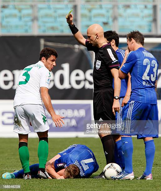 Referee Sergey Karasev shows a yellow card to Dusan Andelkovic of FC Krasnodar during the Russian Premier League match between FC Dynamo Moscow and...