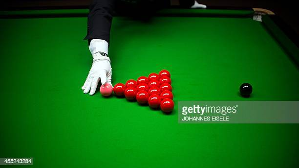 A referee sets up the balls during the Snooker Shanghai Masters in Shanghai on September 11 2014 The World Snooker Masters will take place until...