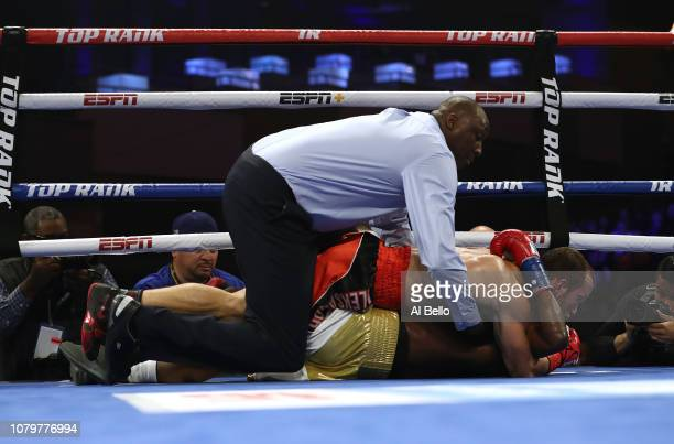 Referee Shada Murdaugh calls time after Alexander Besputin and Juan Carlos Abreu fall to the canvasduring their welterweight fight at The Hulu...