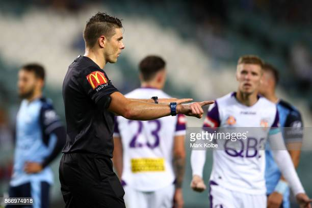 Referee Shaun Evans calls for a referral during the round four ALeague match between Sydney FC and the Perth Glory at Allianz Stadium on October 27...