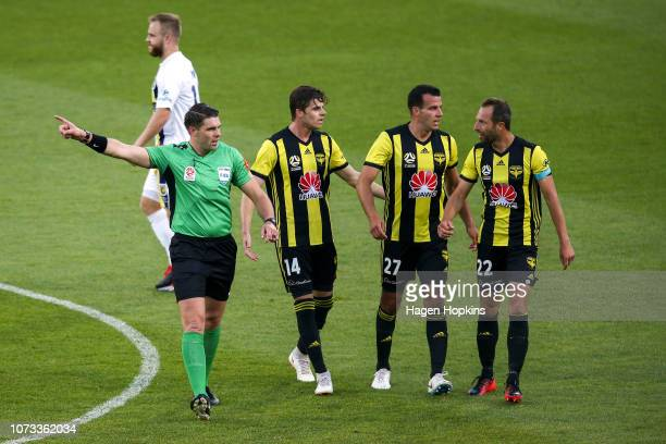 Referee Shaun Evans makes a call while Alex Rufer Steven Taylor and Andrew Durante of the Phoenix look on during the round eight ALeague match...
