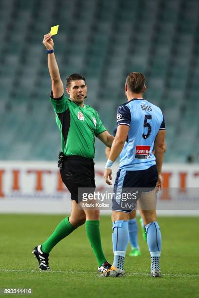 Referee Shaun Evans shows a yellow card to Jordy Buijs of Sydney FC for a tackle on Nick Fitzgerald of City FC during the round 11 ALeague match...