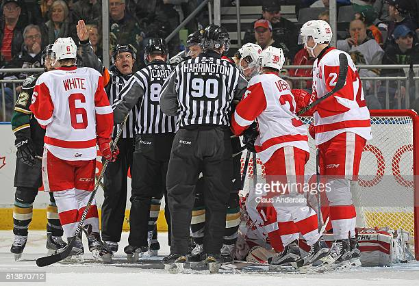 Referee Shawn Hamelin tries to control a scrum between the Sault Ste Marie Greyhounds and the London Knights during an OHL game at Budweiser Gardens...