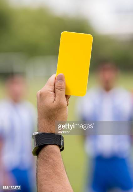 referee showing a yellow card at a soccer game - yellow card stock pictures, royalty-free photos & images