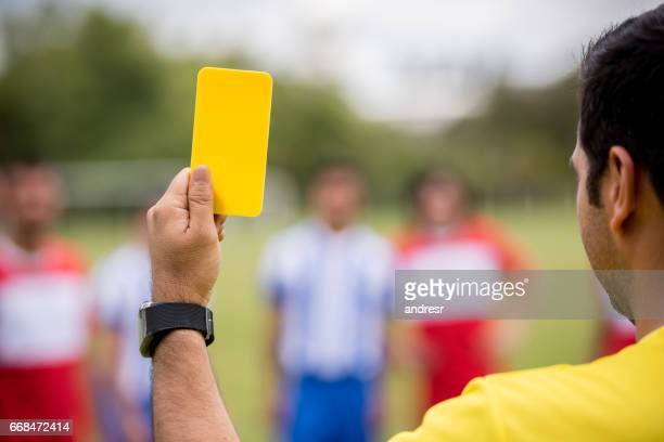 referee showing a yellow card at a soccer game - yellow card sport symbol stock pictures, royalty-free photos & images