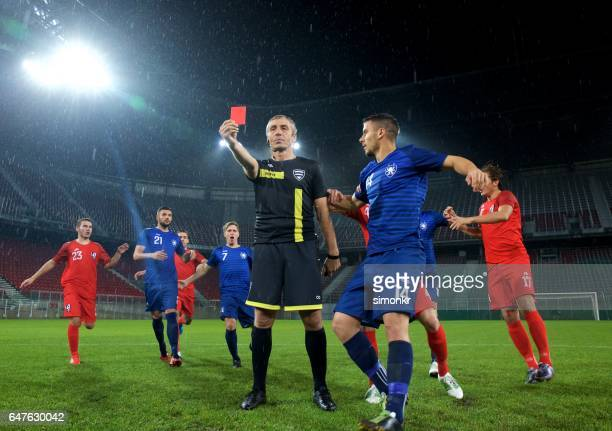 referee showing red card - soccer referee stock photos and pictures