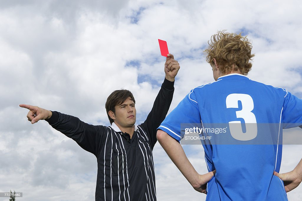 Referee showing red card : Foto de stock