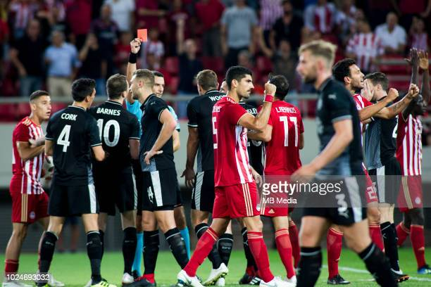 Referee showing red card to Ben Gibson of Burnley FC during the Europa League Qualifying PlayOffs 1st Leg match between Olympiacos FC and Burnley FC...