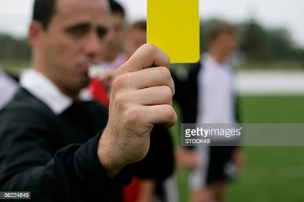 referee showing the yellow card - yellow card stock pictures, royalty-free photos & images