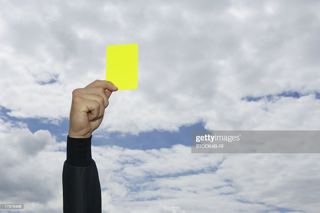 Referee showing yellow card : Photo