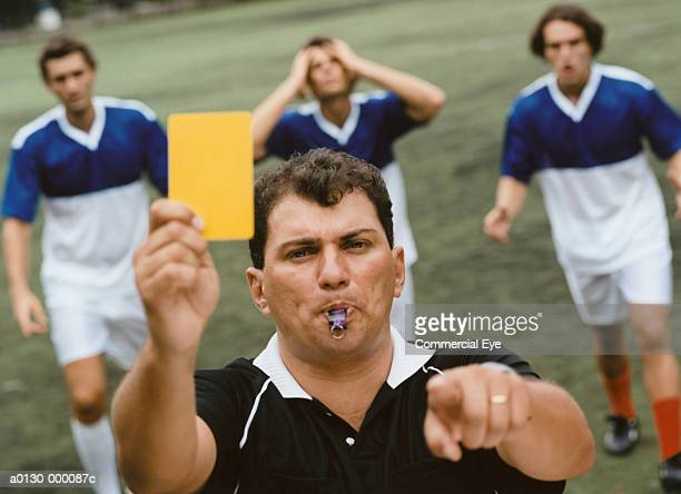 referee showing yellow card - yellow card stock pictures, royalty-free photos & images