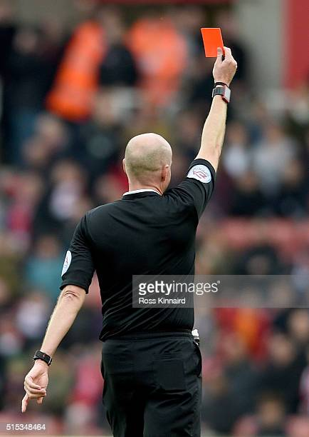 A referee shows a red card during the Barclays Premier League match between Stoke City and Southampton at the Britannia Stadium on March 12 2016 in...