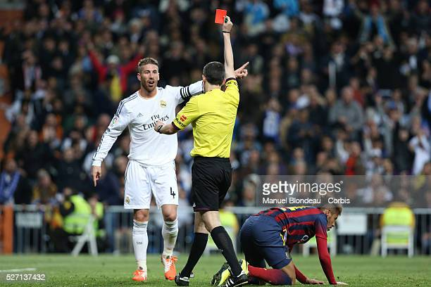 referee shows a red card to Sergio Ramos of Real Madrid during the La Liga football match between Real Madrid and FC Barcelona at Santiago Bernabeu...