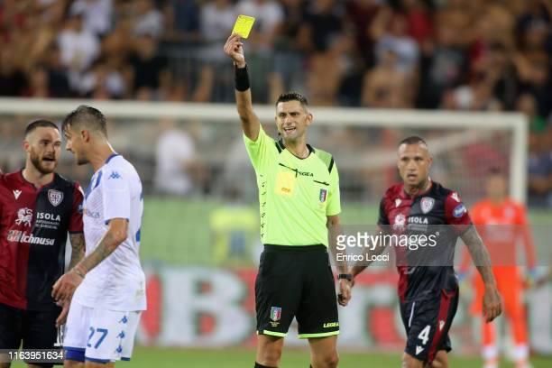 Referee shows a yellow card to Daniele Dessena of Brescia during the Serie A match between Cagliari Calcio and Brescia Calcio at Sardegna Arena on...