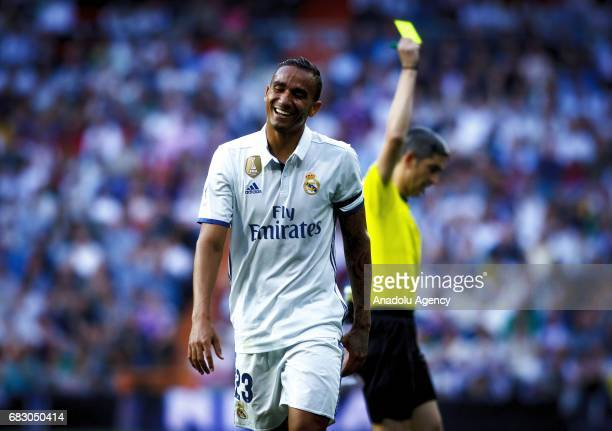 Referee shows a yellow card to Danilo Luiz Da Silva of Real Madrid during the La Liga match between Real Madrid and Sevilla at Santiago Bernabeu...