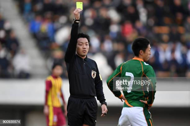 Referee shows an yellow card during the 96th All Japan High School Soccer Tournament 3rd Round match between Aomori Yamada and Nagasaki Institute of...