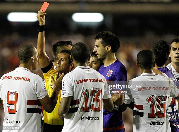 Referee shows Luis Fabiano of Sao Paulo the red card during a match between Tigre from Argentina and Sao Paulo from Brazil as part of Bridgestone...