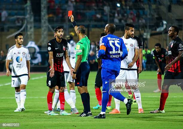 Referee shows red card to Habib Fardan of Al Ahli Dubai during the Arabian Gulf Super Cup match between United Arab Emirates teams AlJazira and...