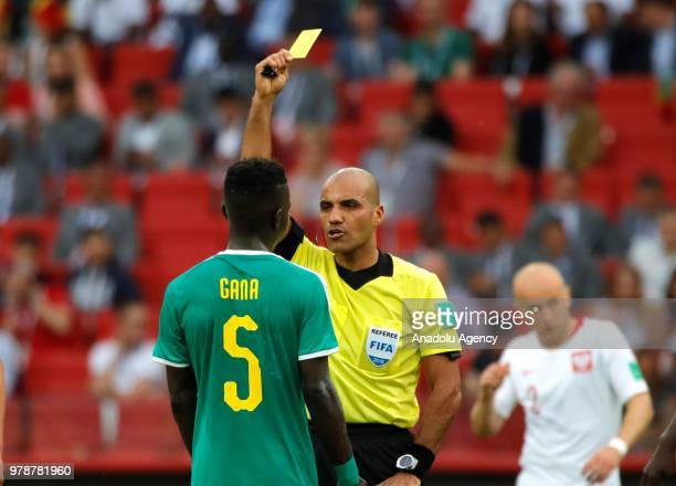 Referee shows yellow card to Idrissa Gana Gueye of Senegal during the 2018 FIFA World Cup Russia Group H match between Poland and Senegal at the...