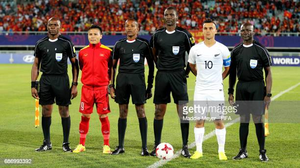 Referee Sidi Alioum of Cameroon center with his officiating team and Quang Hai Nguyen of Vietnam and Clayton Lewis of New Zealand before the FIFA U20...