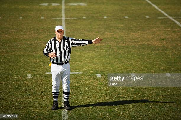 referee signaling penalty - american football referee stock pictures, royalty-free photos & images