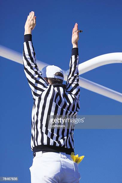referee signaling touchdown or successful field goal - american football referee stock pictures, royalty-free photos & images