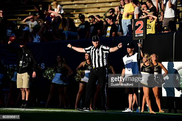 A referee signals during a game between the Colorado Buffaloes and the Idaho State Bengals at Folsom Field on September 10 2016 in Boulder Colorado