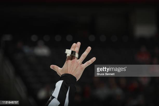 A referee signals for the benches to stop line changes during the game between the New Jersey Devils and the Ottawa Senators at the Prudential Center...