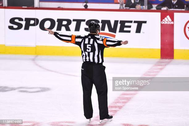 A referee signals no goal for the Calgary Flames during the second period of Game Five of the Western Conference First Round during the 2019 Stanley...