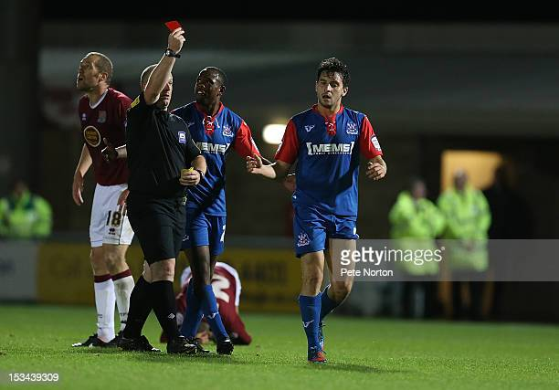 Referee Simon Hooper shows a red card to Charlie Allen of Gillingham during the npower League Two match between Northampton Town and Gillingham at...