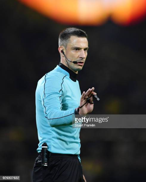 Referee Slavko Vincic signals during the UEFA Europa League Round of 16 match between Borussia Dortmund and FC Red Bull Salzburg at the Signal Iduna...