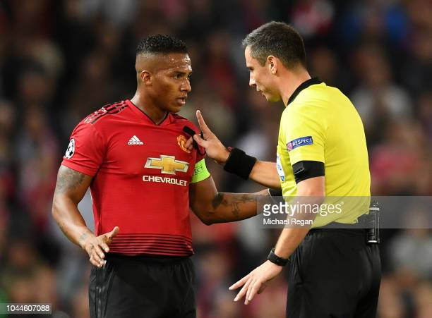 Referee Slavko Vincic speaks to Antonio Valencia of Manchester United during the Group H match of the UEFA Champions League between Manchester United...