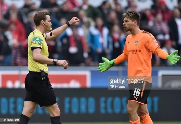 Referee Soeren Storks and Goalkeeper RonRobert Zieler of Stuttgart gesture during the Bundesliga match between 1 FC Koeln and VfB Stuttgart at...