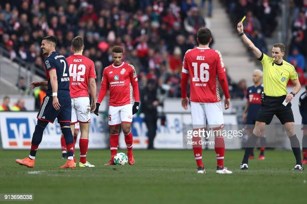 Referee Soeren Storks does Sandro Wagner of Muenchen a yellow card during the Bundesliga match between 1 FSV Mainz 05 and FC Bayern Muenchen at Opel...