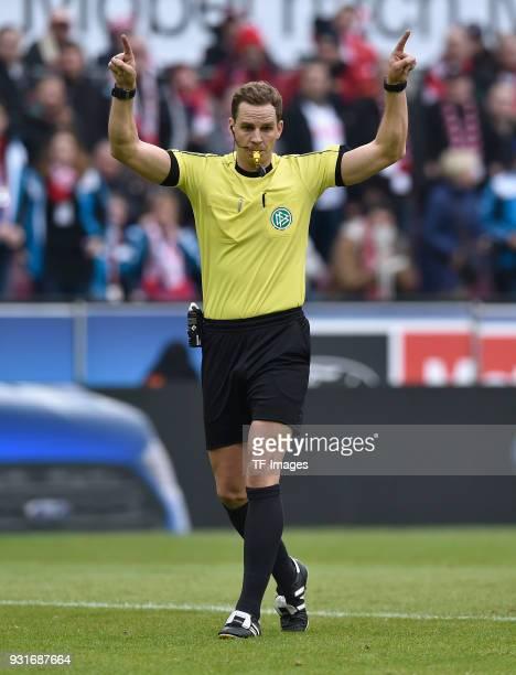 Referee Soeren Storks gestures during the Bundesliga match between 1 FC Koeln and VfB Stuttgart at RheinEnergieStadion on March 4 2018 in Cologne...