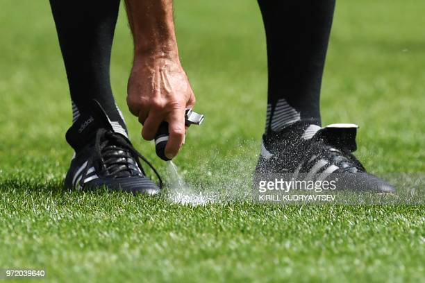 Referee sprays foam on the pitch during a referee's training session at the Lokomotiv stadium in Moscow on June 11 ahead of the Russia 2018 World Cup...