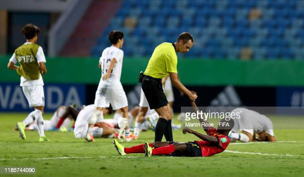 Referee Srdjan Jovanovic helsp up Capita of Angola during the FIFA U-17 World Cup Brazil 2019 round of 16 match between Angola and Korea Republic at...