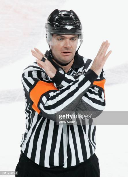 Referee Stephane Auger calls an interference penalty during the game between the Florida Panthers and the New Jersey Devils at the Prudential Center...