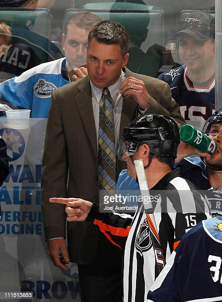 Referee Stephane Auger explains a call to assistant coach Jim Hulton of the Florida Panthers during the third period against the Pittsburgh Penguins...