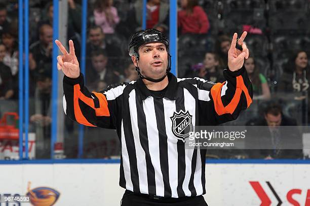Referee Stephane Auger makes a call during the game between the Atlanta Thrashers and the Florida Panthers at Philips Arena on February 6 2010 in...