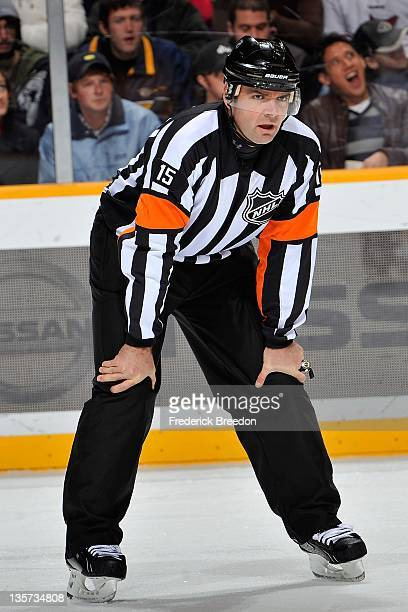 Referee Stephane Auger officiates a game between the Anaheim Ducks and the Nashville Predators at the Bridgestone Arena on December 10 2011 in...