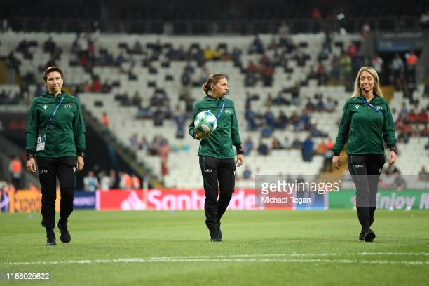Referee Stephanie Frappart and assistant referees Manuela Nicolosi and Michelle O'Neill inspect the pitch prior to the UEFA Super Cup match between...