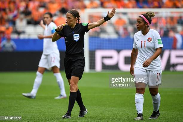 Referee Stephanie Frappart of France gestures next to Canada's midfielder Desiree Scott during the France 2019 Women's World Cup Group E football...