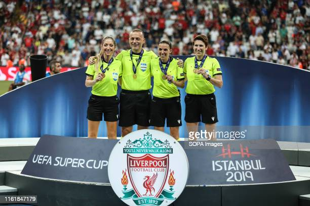 Referee Stephanie Frappart poses with her Assistants Manuela Nicolosi and Michelle O'Neill with their medals at the end of the UEFA Super Cup match...