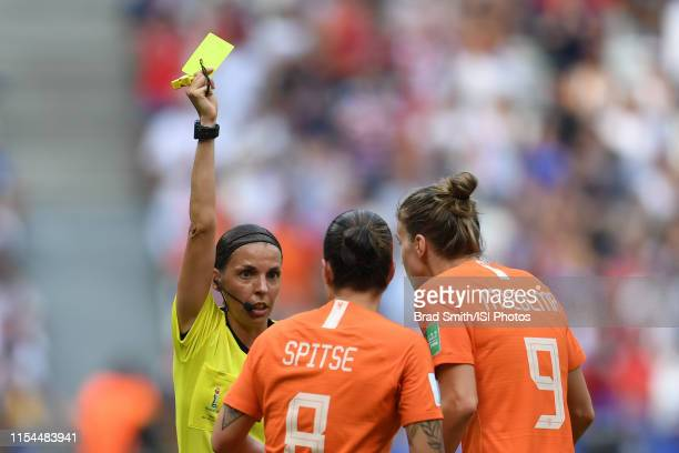 Referee Stephanie Frappart presents a yellow card to Sherida Spitse of the Netherlands as Vivianne Miedema objects during the 2019 FIFA Women's World...