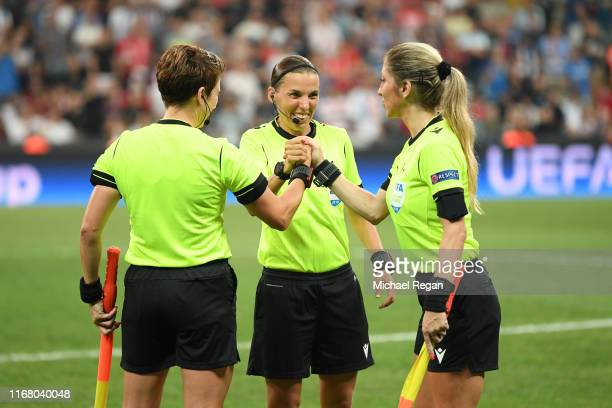 Referee Stephanie Frappart shakes hands with assistant referees Manuela Nicolosi and Michelle O'Neill prior to the UEFA Super Cup match between...
